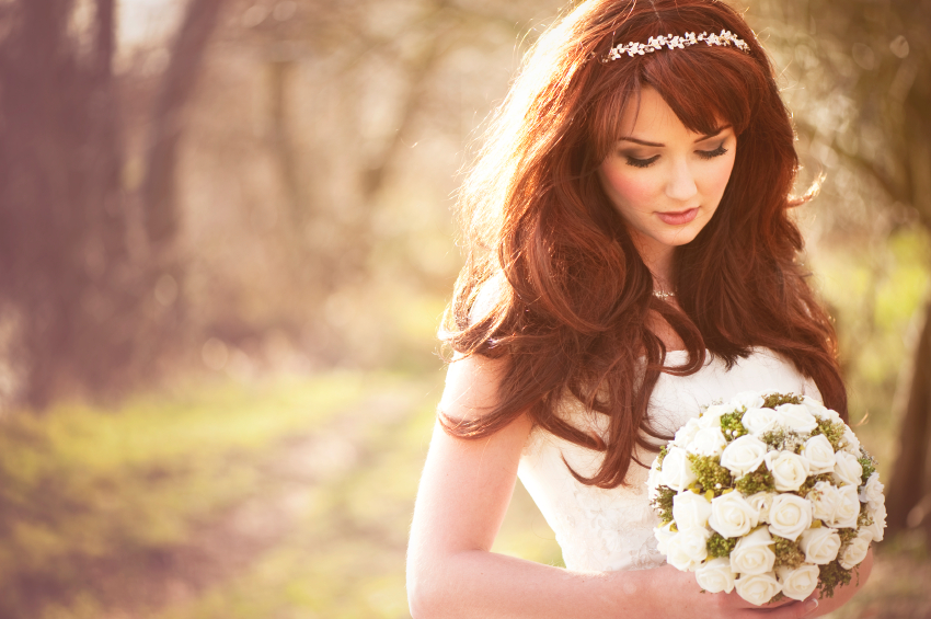 Beautiful bride outdoors in a forest.